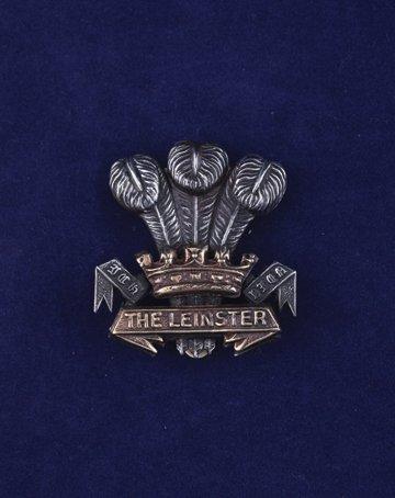 557: The Leinster Regiment cap badge