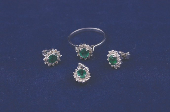Ladies 14 ct. gold emerald and diamond set ring