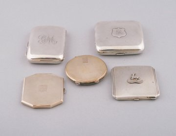 Group of five solid silver cases