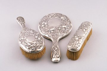 Three piece silver backed vanity set