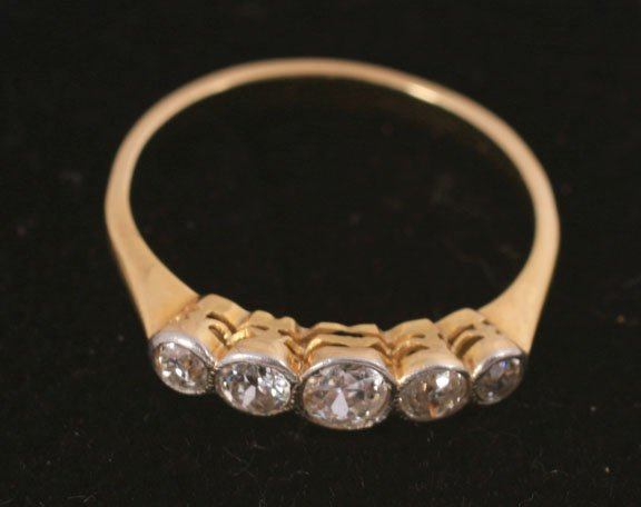 Gold and diamond five stone ring