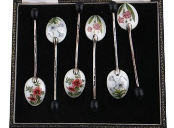 Cased set of six silver and enamelled tea spoons,