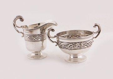 Celtic design silver sugar bowl and cream jug,