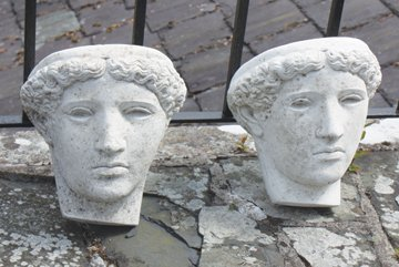Pair of Grecian head wall mounted planters