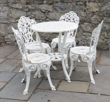 Cast iron patio table and four chairs