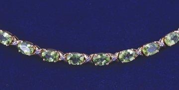 9 ct. gold and peridot bracelet