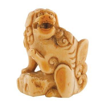 Meiji period ivory netsuke of a fo