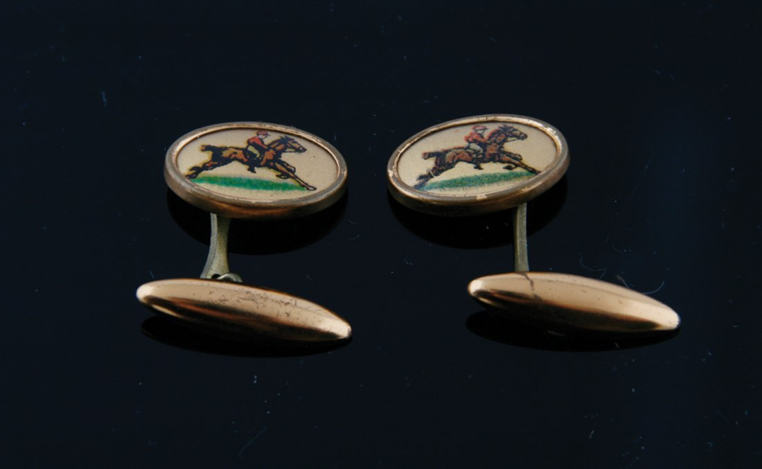 Pair of silver gilt and enamelled equine cufflinks