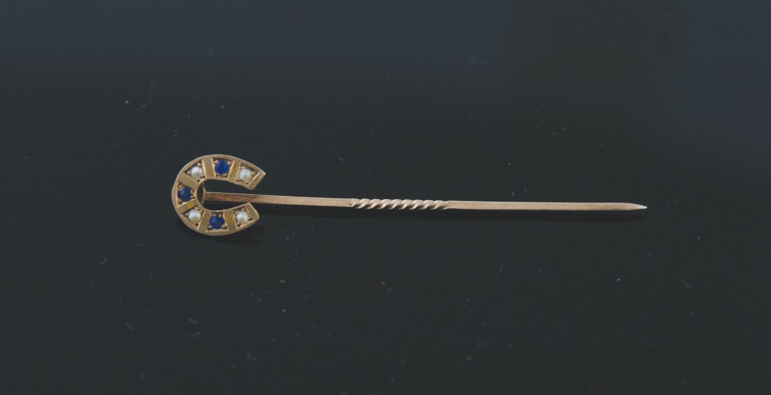 9 ct. gold sapphire and pearl horse shoe shaped stick