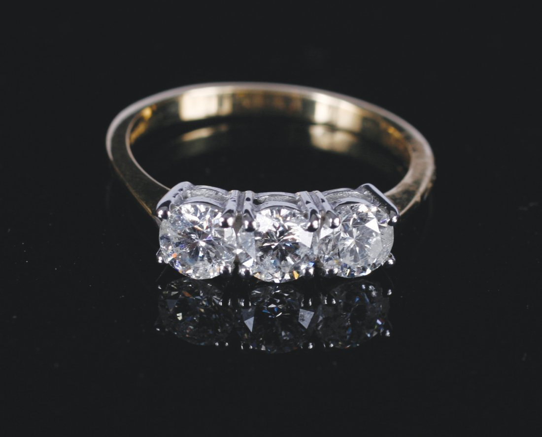 18 ct. yellow gold and diamond three stone ring of 1.5