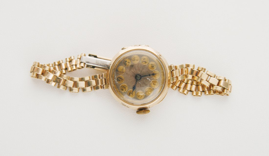 9 ct. gold ladies watch and strap