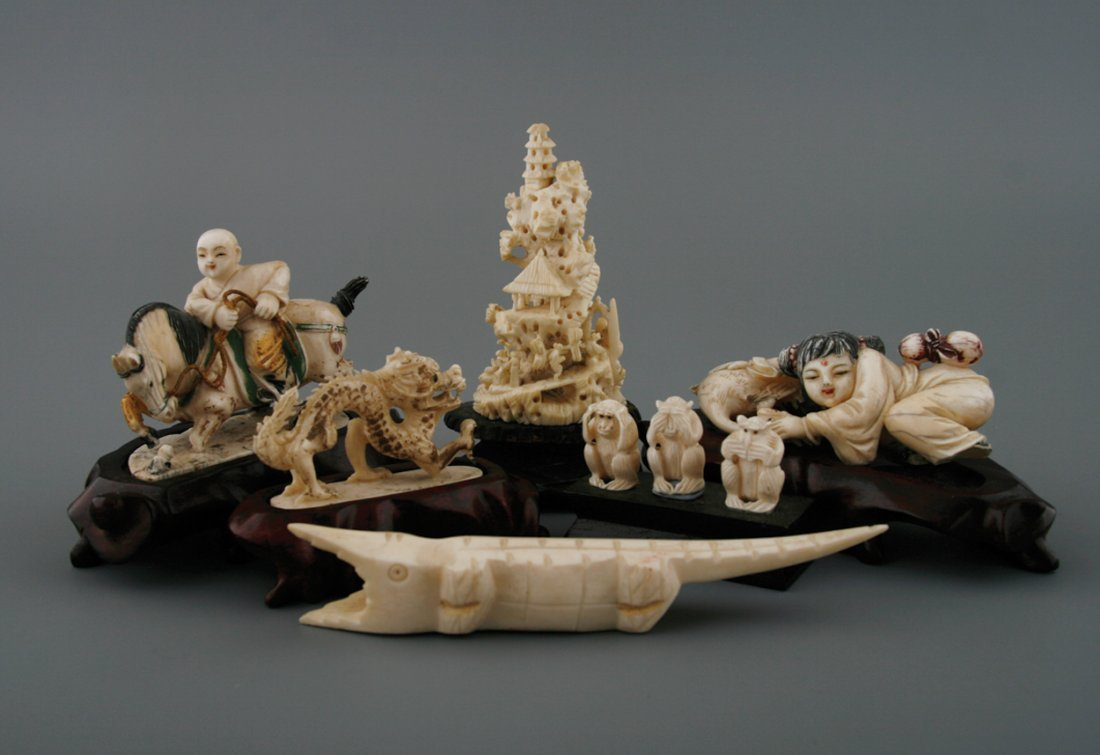 Group of six ivory carvings