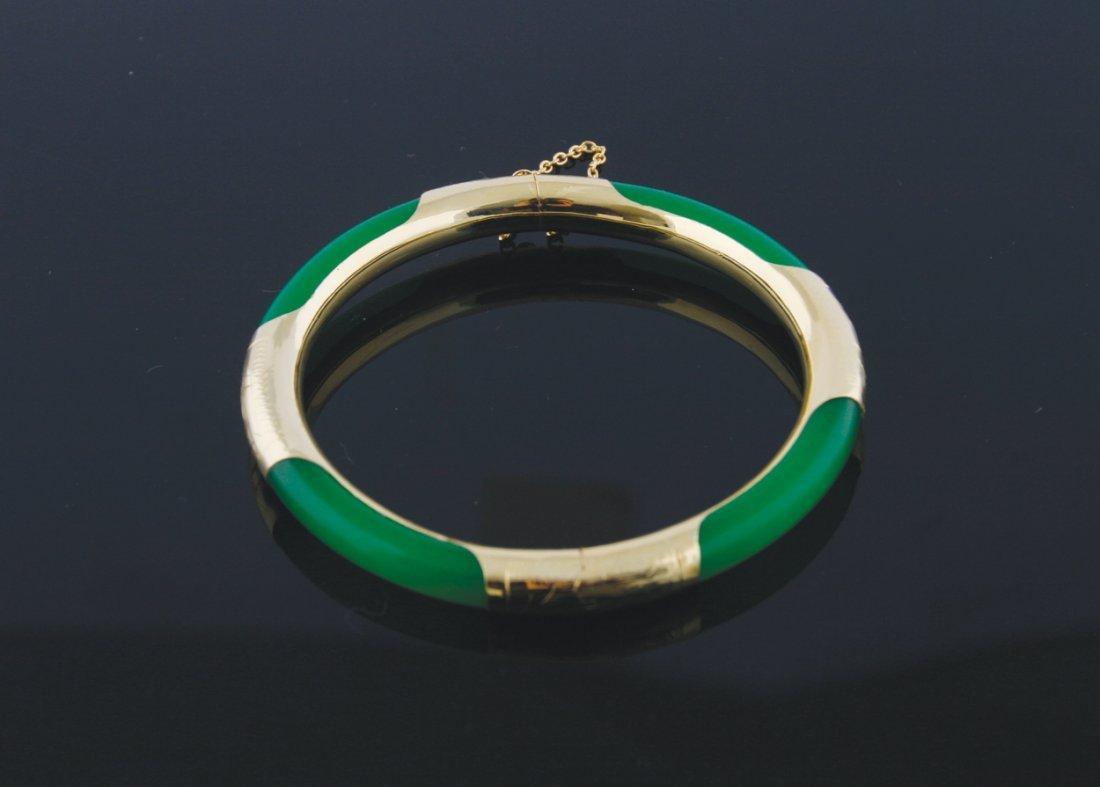 Chinese gold mounted green jadeite bangle