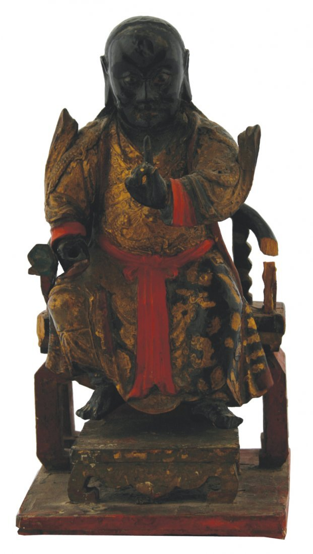 Chinese Qing period lacquered and gilt figure of an