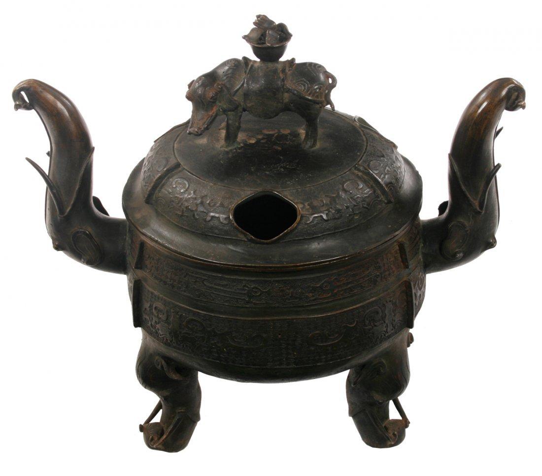 Large archaic Chinese bronze elephant tripod censer