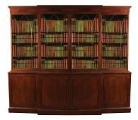 George III period mahogany breakfront bookcase, circa