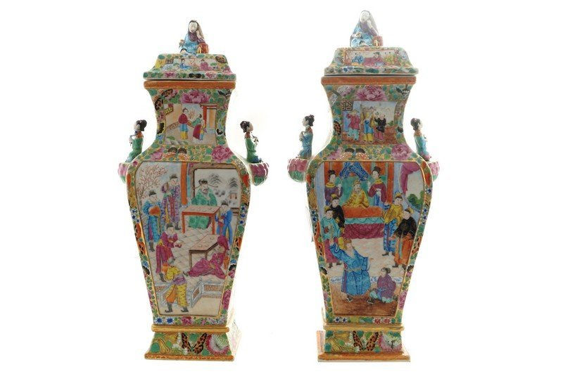 A pair of Chinese famille rose lidded vases, nineteenth