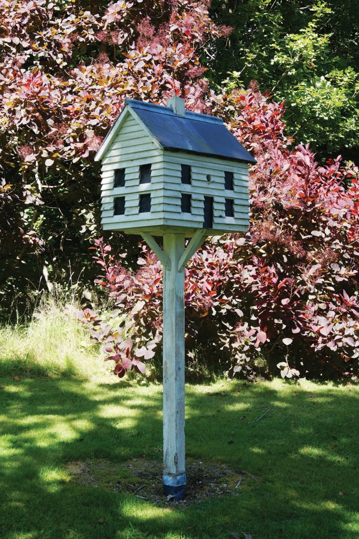 WOODEN BIRD-HOUSE ON STAND