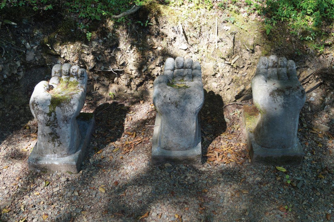 GROUP OF THREE STONE SCULPTURES
