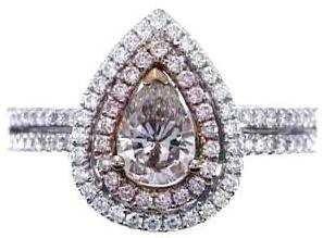 926: 18KW FANCY PINK DIAMOND RING