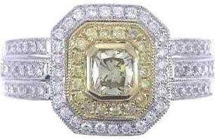 521: 18K FANCY YELLOW DIAMOND RING