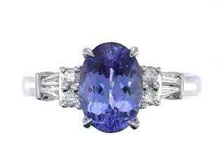 1215: 14kw Tanzanite & Diamond Ring