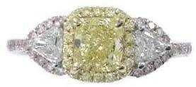 947: 18K FANCY YELLOW DIAMOND RING