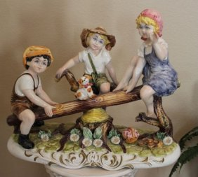 100017: RARE CAPODIMONTE - CHILDREN ON SEE-SAW - PORCEL