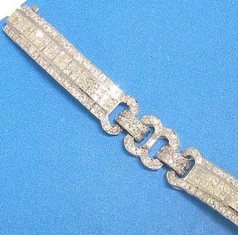 100031: 14K GOLD DIAMOND BRACELET