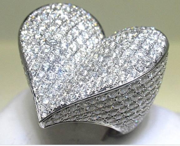 100027: 14K GOLD DIAMOND RING