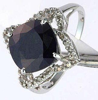 600166: 4.94 CTW.  SAPPHIRE & DIAMOND RING - 10KW GOLD