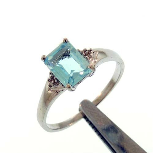 1.85CT BLUE TOPAZ AND DIAMOND STERLING RING