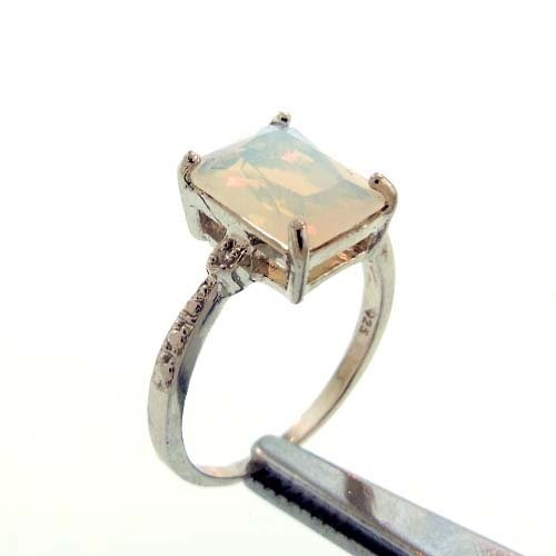 2.6CT LAB OPAL AND DIAMOND STERLING RING