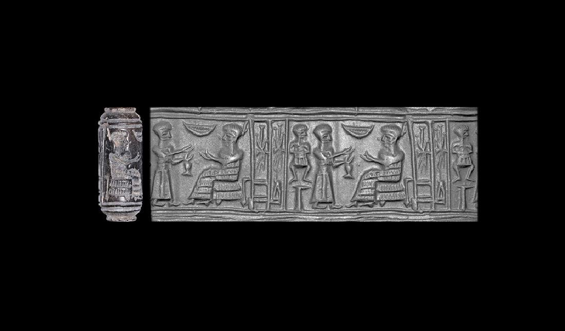 Elamite Cylinder Seal with Figures and Inscription