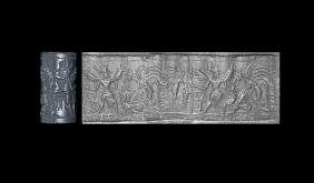 Cylinder Seal with Winged Deity and Symbols
