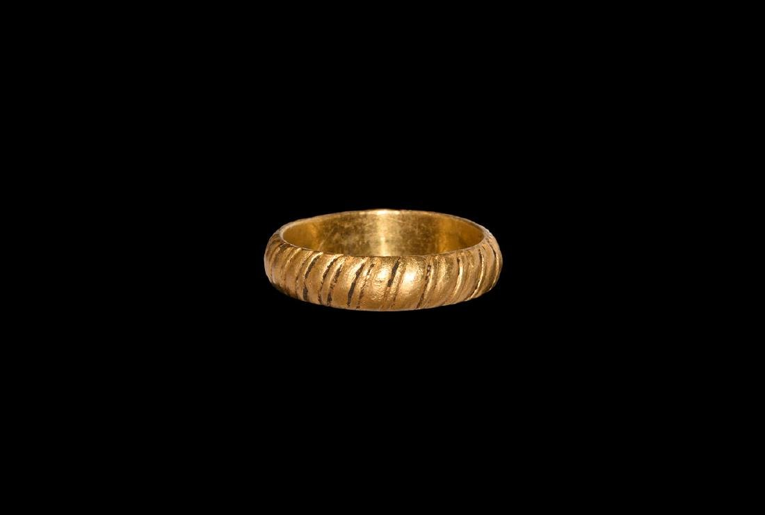 Medieval Gold Ring with Rope Design