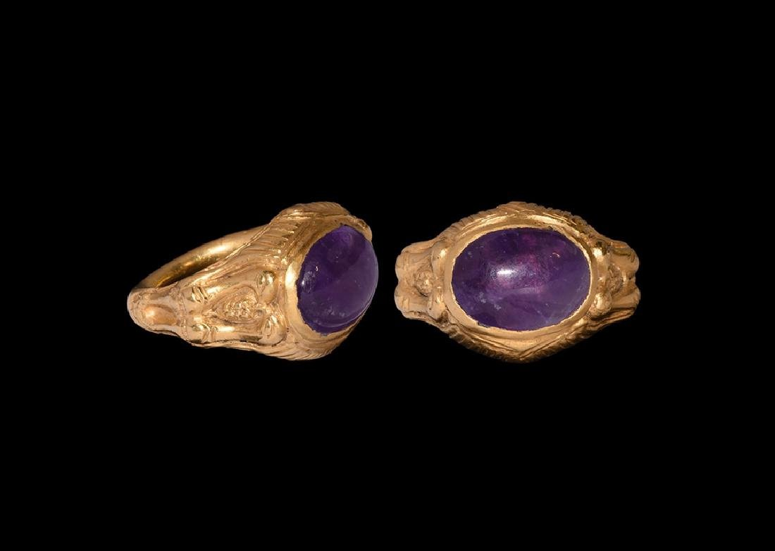 Gold Ring with Birds and Amethyst Cabochon