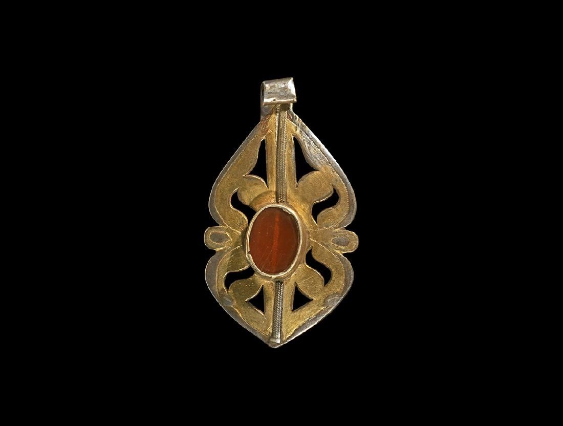 Central Asian Gilt Pendant with Bead