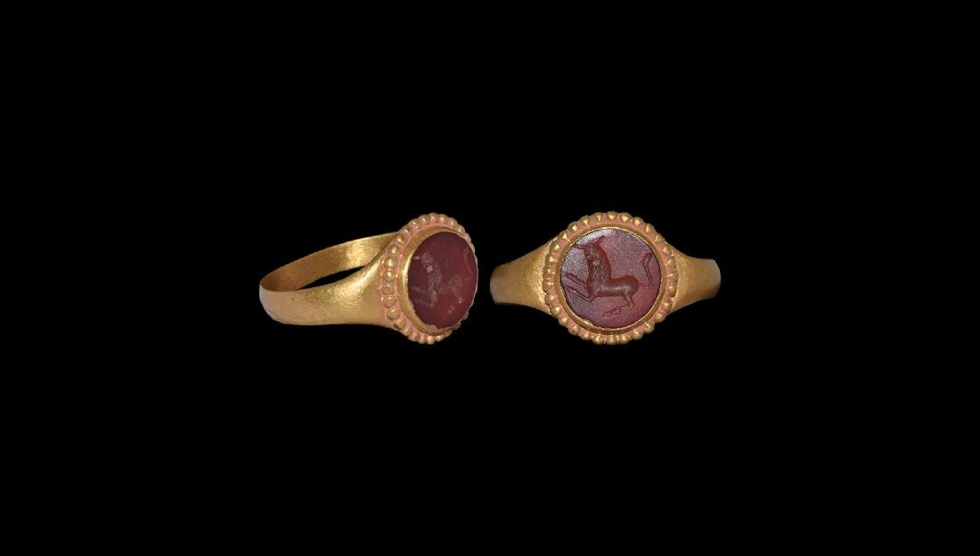 Roman Style Gold Ring with Charging Bull Intaglio.