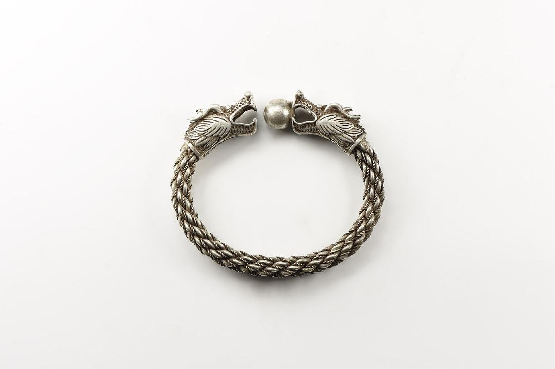 Chinese Twisted Bracelet with Dragon-Head Terminals.