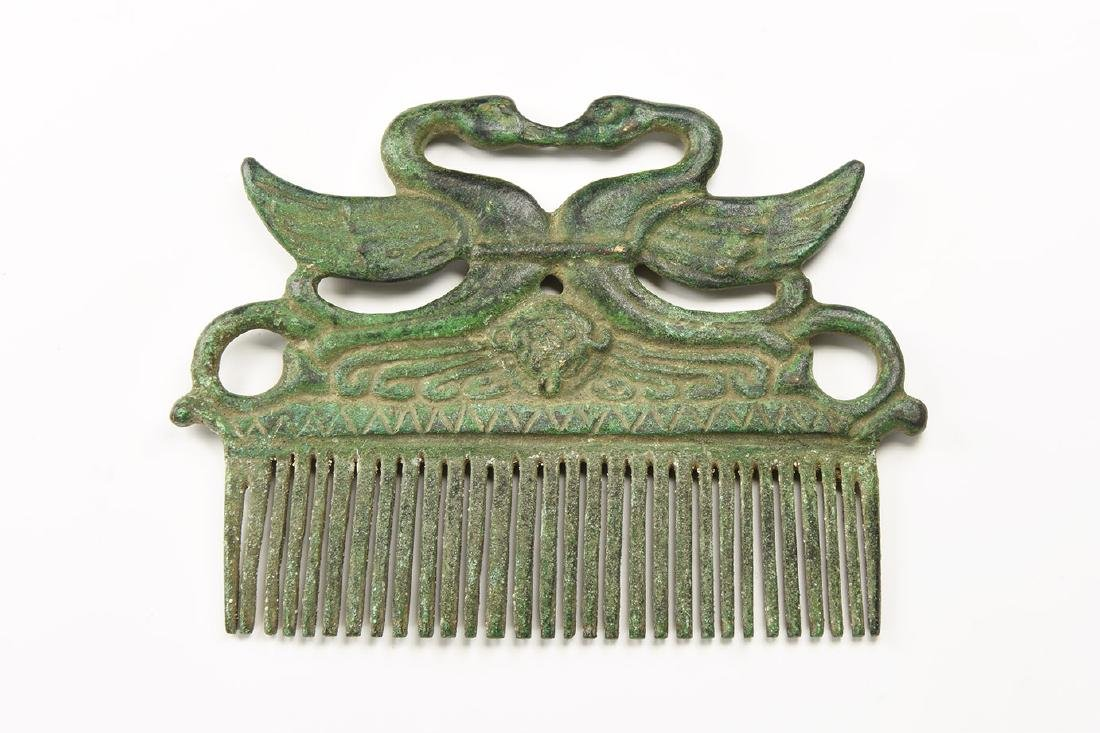 Roman Style Comb with Swans and Trumpets.