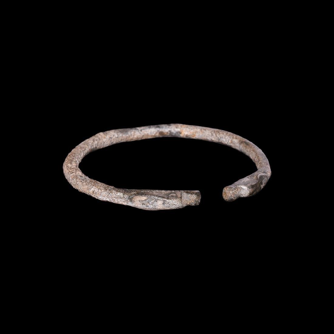 Western Asiatic Silver Bracelet with Animal Head