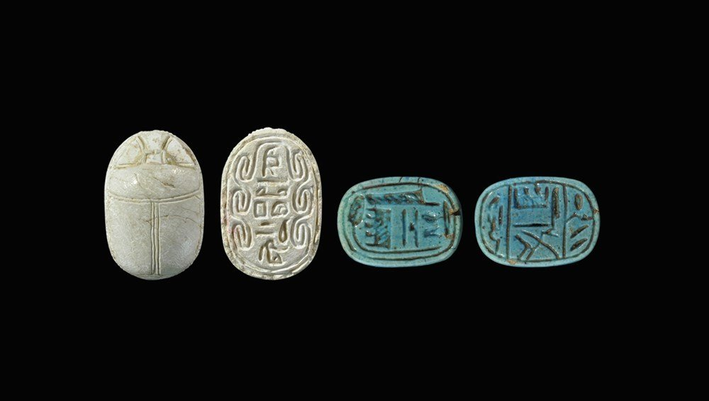 Egyptian Glazed Composite Scarab and Amulet Group