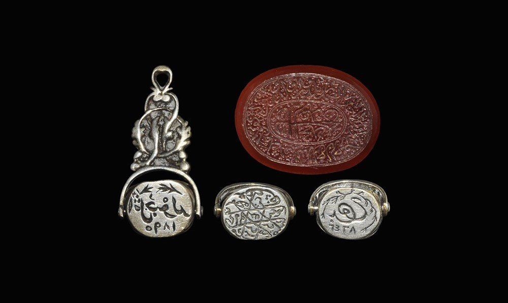 Islamic Silver and Carnelian Epigraphic Intaglio Pair