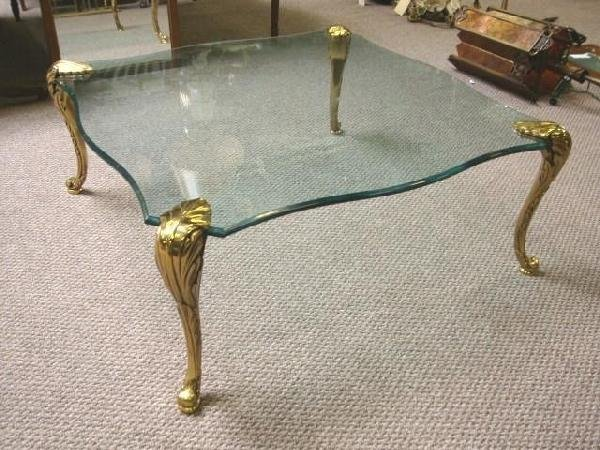57: Glass top coffee table with gilt-brass legs