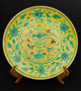 CHINESE YELLOW CHARGER WITH INCISED GREEN FLOWERS