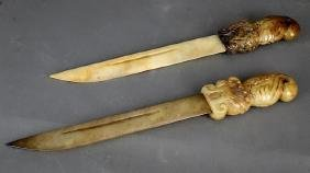 TWO ANTIQUE CHINESE CARVED JADE SWORDS
