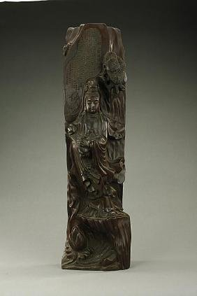 CHINESE CARVED WOODEN FIGURE OF A STANDING GUANYIN