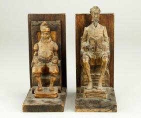 PAIR OF CARVED WOOD BOOKENDS OF SEATED MEN
