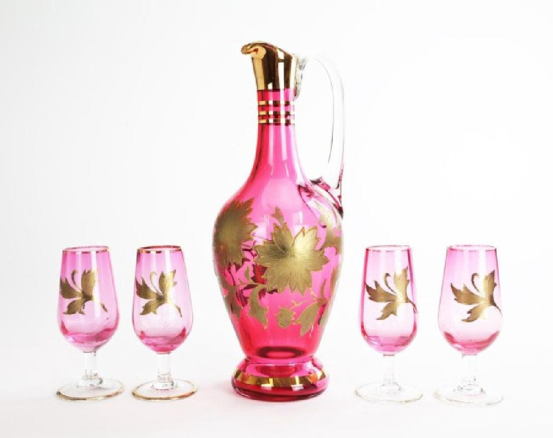 CRANBERRY GLASS DECANTER AND FOUR GLASSES